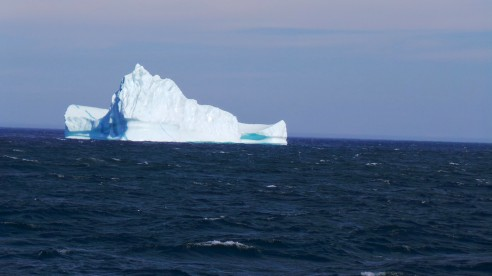 "We couldn't venture too close to the largest icebergs, of course.  Something like 9/10ths of an iceberg looms hidden under the water.  Aside from being large, this unseen mass is unpredictably shaped and may topple over (or ""founder"") at any time."